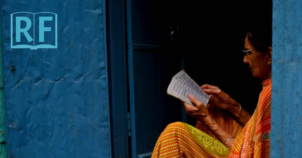 Sitting and reading the Dhammapada in a doorway in India